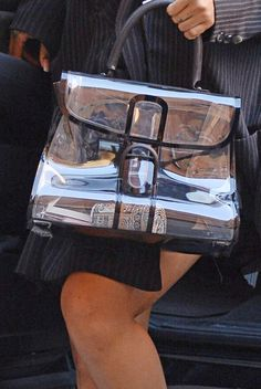 (Details) Rihanna carriyng a $5000 Alexander Wang x Judith Lieber Money Roll Clutch Purse inside of a clear plastic purse while heading to a photoshoot in New York City. (October 19, 2017)