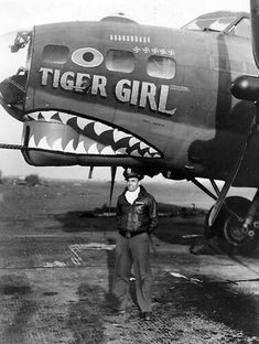"""Vintage Aircrafts - A crew member in front of """"Tiger Girl"""" of the Bomb Group Nose Art, Ww2 Aircraft, Military Aircraft, Fighter Aircraft, Military Art, Military History, Tiger Girl, Aircraft Painting, Airplane Art"""
