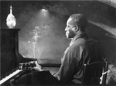 "Atmospheric: Big Bill Broonzy on the movie set of ""Low Light and Blue Smoke"", Brussels, December 1955. from ""I Feel So Good: The Life and Times of Big Bill Broonzy by Bob Riesman"