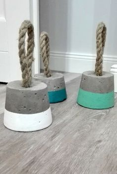 Imagine these door stoppers made with nautical rope, copper pipe, and chucks of driftwood instead of concrete