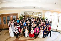 Wedding group photo with Mickey Mouse at a Citricos Disney Wedding