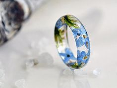 Eco resin ring with natural moss, forget-me flowers.  Making my rings I use only natural materials: routs of plants, flowers, leaves, elements of trees, moss, natural coloring matter etc.    I create rings for women that love natural style.    Rings of plants keep nature's soul and underline women's tiffany natures.    All of the adornments are created in a positive soul move.  All sizes