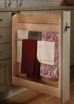Would love linen storage for tablecloths in the cabinets attached to support posts. Pull Out Towel Cabinet