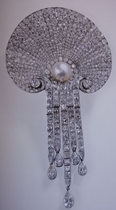 The Queen`s Courtauld Thomson Scallop Shell brooch, formerly a favourite of the Queen Mother.