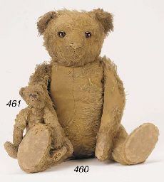 Old TatteredTeddy with a baby teddy...obviously very loved