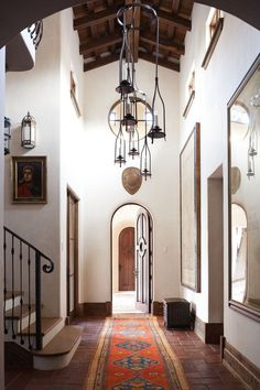 Home Decor – Entryway : An antique rug tops the tile floor and beyond the antique oak entry door, the matching entry door to the guest house (on the opposite side of the courtyard) can be seen. – Mediterranean Homes & Lifestyles ® / Photo: Edmund Barr / Design: Shelly ...