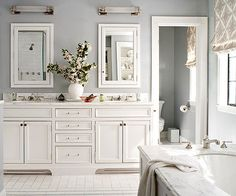 Light walls and white cabinets and vanity. Better homes and gardens