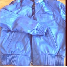 Leather jacket Blue soft real leather jacket from Donna Sacs. In good condition, only wore about 5 times. Says small but fits like an extra small. 6 pockets, 3 on the outside and 3 in the inside Jackets & Coats