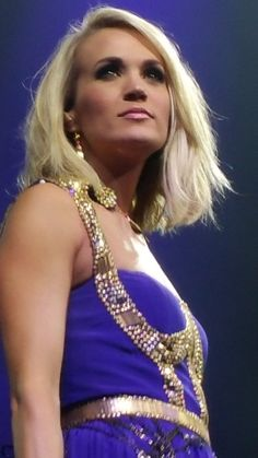 carrie underwood purpe gown in storyteller tour //www//carriefans.com