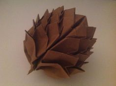 origami pinecone folded by my cousin Daniel, designed by Beth Johnson Origami | http://bethorigami.wordpress.com/instructions/diagrams/
