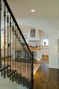 Love the iron rails mounted on the outside of the staircase