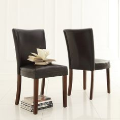 These leather upholstered dining chairs are classic and timeless and would blend effortlessly with any interior decor. Ideal for dinner parties, this set of two dining chairs features comfortable bi-cast leather seats and a classic espresso finish.