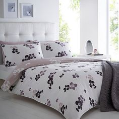 A lovely finish to your bedroom, this duvet cover from our exclusive designer Betty Jackson.Black comes in a white and lilac wild rose print with a contrast reverse.