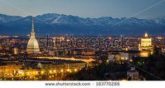 Turin (Torino), night panorama with Mole Antonelliana and Alps - stock photo