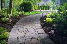 Paver Manufacturer: Belgard, Paver Style: Mega Arbel, Paver Color: Rio, Paver Pattern: Random with a Bergerac Border in a runner pattern