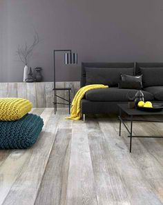 Love the grey tones of the floor.  The yellow accents, not so much.  Maybe a deep wine instead?