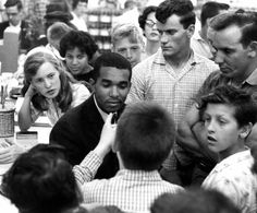 Dion Diamond, a student at Howard University is surrounded by white youths during a sit-in demonstration Arlington, Virginia, June 9, 1960 U...