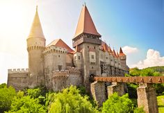 Castle-Romania -Transylvania from the Dracula story. According to the legend, Bran Castle in Romania is where Dracula lived. Around the castle, there are mountains which are great for climbing, hiking and bathing in the natural thermal spas. Romanian Castles, Honeymoon Tour Packages, Dracula Castle, Rail Europe, Buda Castle, Romania Travel, City Pass, Medieval Castle, Medieval Gothic