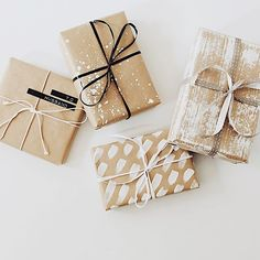 simple and pretty packaging with kraft paper, satin ribbons and black and white details
