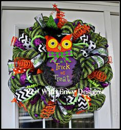 This bright and fun Halloween Owl Wreath is just adorable. It is made out of Deluxe Green and Black Deco Mesh, has six different types of