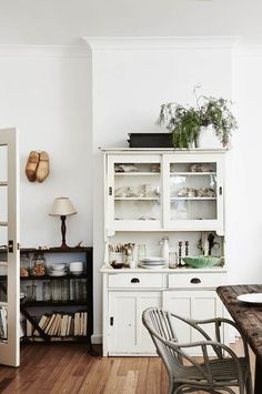 A mix of vintage, industrial and new pieces have been pulled together over the years to create the special character in the home. Kate's grandmother's lamp sits on the kitchen bookcase, which was rescued from the shed. The wooden clogs hanging above are f Farmhouse Dining Room, House Interior, Dining Room Design, Home Kitchens, Interior, Home Decor, Dining Room Decor, Kitchen Bookcase, Vintage Home Decor