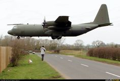 Hercules crossing the road ( why did the Hercules cross the road ? To land on the nearby landing strip of course !! ) ( lol )