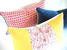 Bright Red Ikat Pillow Cover, Red Decorative Pillow Cover, Bohemian Decorative Pillows, Yellow and Blue Sofa Cushion Covers 12x22 Inch. $35.00, via Etsy.