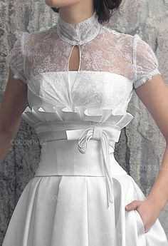 """This elegant and chic Wedding dress made from Mikado. """"Vesta"""" gown is offered with a rich Chantilly lace bolero with short sleeves."""