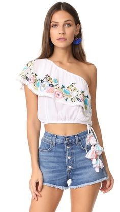 ¡Consigue este tipo de top corto de RahiCali ahora! Haz clic para ver los detalles. Envíos gratis a toda España. RahiCali Bliss Asymmetrical Top: Pastel embroidery adds charm to this one-shoulder RahiCali crop top. Gathered elastic neckline and gathered elastic hem with tasseled ties. Sleeveless. Fabric: Crepe. 100% rayon. Hand wash or dry clean. Imported, India. Measurements Length: 16.5in / 42cm, from shoulder Measurements from size S (top corto, crop tops, crop top, croptops, croptop…