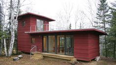 McGlasson weeHouse -- A small prefab home in Northern Minnesota designed by Alchemy Architects. designed by award winning architect Geoffrey Warner. The super-clean, modern cabin has 2 bedrooms, 1 bath, two decks. Second floor bedroom has exterior access via ship's ladder and a deck for a bird's eye view and an amazing view of the stars.  Rents for $230/night: http://tinyhousevacations.com/property/weehouse-cabin/