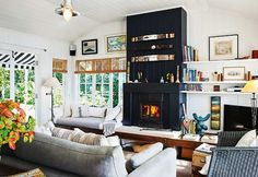 looks like a real efficient wood burning stove...love the white of the room!