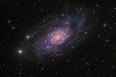 Magnificent island universe NGC 2403 stands within the boundaries of the long-necked constellation Camelopardalis.