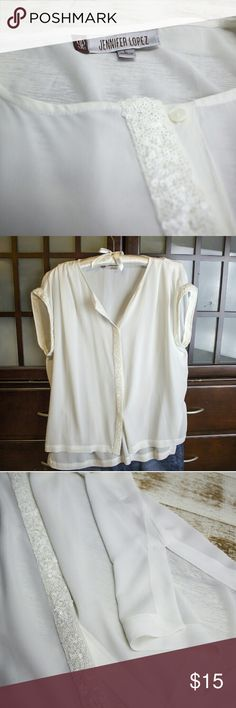 White sheer JLO blouse Sheer white Jennifer Lopez blouse with white sequins on edge of sleeves and down the front. Size on tag is large, but also a nice fit for a medium. Very slight discoloration near hem at bottom, barely visible by photograph (see photo #4). Flirty and unique! Great for business casual or a night out! Jennifer Lopez Tops Blouses