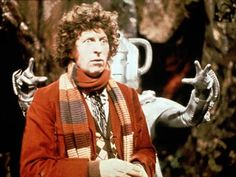 Doctor Who: Tom Baker as the Fourth Doctor about to be attacked by (what looks like) a Cyberman
