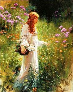 Woman in garden picking flowers