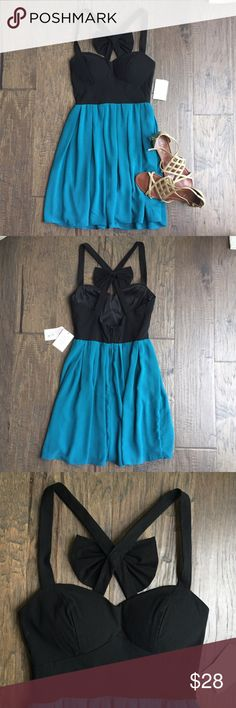 Cutout Bow-Back dress Beautiful black and teal formal dress. Straps cross in the back, leaving a cutout with a bow in the center. NWT, never worn. Excellent condition.  Chest is padded. Juniors size 7/8, but it RUNS SMALL. B Darlin Dresses