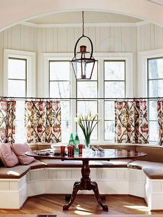 Choose a table that follows the lines of your banquette bench for optimal seating and movement: http://www.bhg.com/rooms/dining-room/themes/small-space-dining-room-decorating-ideas/?socsrc=bhgpin092414richwarmth&page=5