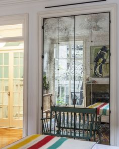 May 2013 Issue - A green bench set against doors covered with antique mirror panes