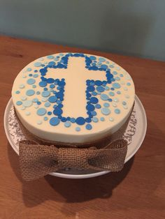 Boy communion cake with burlap bow.
