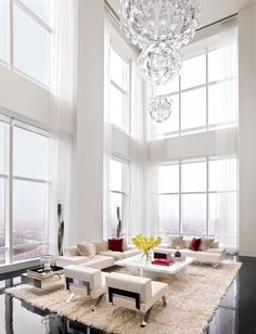 Simple and serene, these elegant living spaces make a statement with all-white motifs.