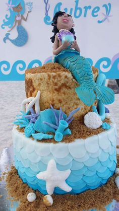Sand castle cake at a mermaid birthday party!  See more party planning ideas at CatchMyParty.com!