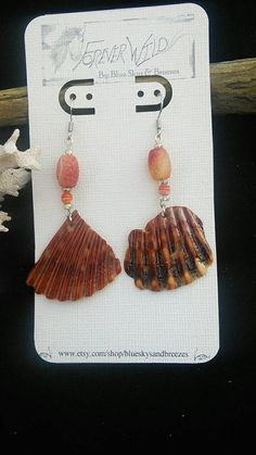 Check out this item in my Etsy shop https://www.etsy.com/listing/212084064/shell-earrings-with-beautiful-bead