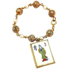 Pearl Gold Bracelet With Mahjong Tile Charm  | From a unique collection of vintage charm bracelets at https://www.1stdibs.com/jewelry/bracelets/charm-bracelets/