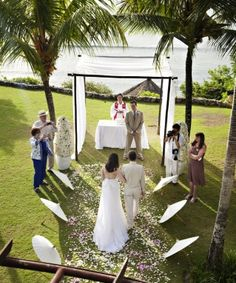 A Real Bali Wedding: Vicky and David's intimate wedding used Balinese umbrellas to line their simple, elegant aisle by www.blissweddings.asia