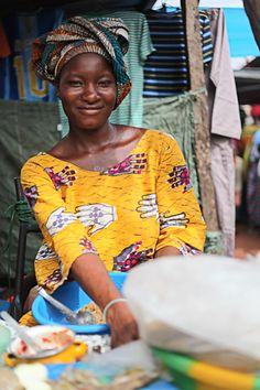 She looks very content as she works in the market place. Yanfolila in southern Mali, West Africa. Photo credit: Laura Cook.