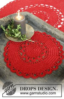 "Christmas Morning - DROPS Christmas: Crochet DROPS round tablecloth in 1 strand ""Cotton Viscose"" and 1 strand ""Glitter"" - Free pattern by DROPS Design"