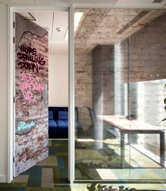 Exposed brick effect and graffiti style artwork give this meeting room an urban feel: