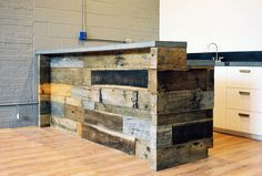 industrial looking reclaimed wood reception desk with concrete countertops