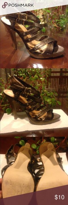 STRAPPY BRONZE HEEL. 🎉 41/2 inch bronze brown color. Gently worn. All in all condition is good. ChrisCross straps. Soles r in good condition. Little bit of scuffs on bottom shows gently worn. The heel it self is not in worn down at all. DELICIOUS Shoes Heels