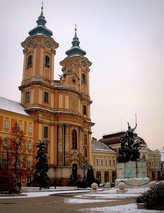 Maronite Eger church and Dobo Istvan square in snow, Eger, Hungary